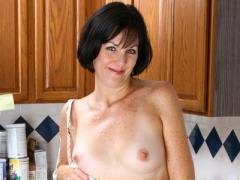 Freckled Mature Woman Posing In Kitchen Movies