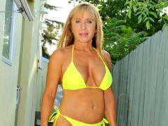 Mature Blonde In Bikini Posing Outdoor Movies