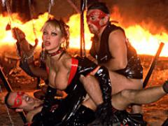 Brutal Fetish Action With Leather And Chains Between Fire