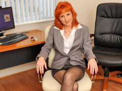 Horny Business Woman Begins To Undress In The Office
