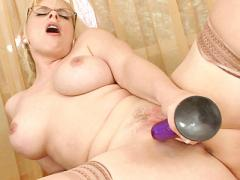 Alluring Blonde Business Woman Masturbates With A Purple Toy