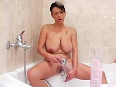 Sexy Busty Brunette Relieves Herself In The Bath