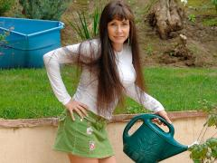 Captivating Older Lady Waters Her Plants In A Mini Skirt