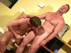 Muscle Man Bear Gagging Over A Huge Cock In The Living Room