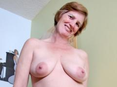 Curvaceous Red Haired Grandma Shows Off Her Big Tits At Anil...