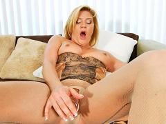 Busty Blonde Cougar In Lingerie Masturbates With A Glass Dic...
