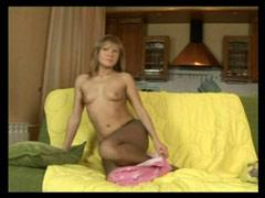 Young Tart With Small Tits Poses In Sheer Nylons