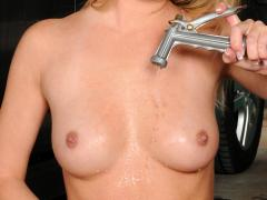 Busty Nubile Hottie Sprays Her Bare Tits With A Water Hose O...