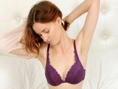 Slender Red Haired Cutie Slips Off Her Top Revealing Her Lace Bra