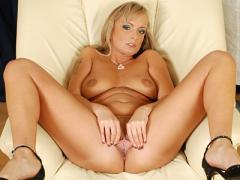 Tanned Anilos Sweetie Eve Adams Massages Her Large Supple Tits