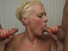 Lovely Short Haired Blond Gets 2 Fat Cocks To Suck On