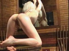 This Angel Blond Looks Into The Mirror And Enjoys Her Own Nudity In This Video
