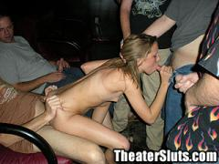 Teen Girl Taking On A Group Of Strangers In A Dirty Porn Theater